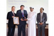 Gary Garner, EVP Group Services, Chris Tabet, Air BP receiving award from HE Jamal Al Hai, Deputy CE