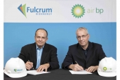 R E.James Macias, President and CEO of Fulcrum, signs agreement with David Gilmour, Vice President T